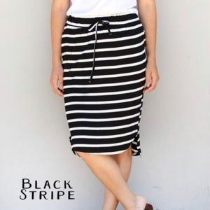 New in package. Black/white striped skirt.